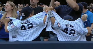 Kids wearing new York Yankees t-shirt for Rivera