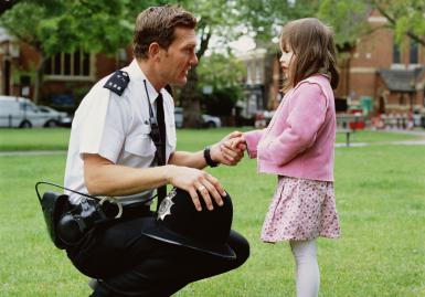 Policeman and girl