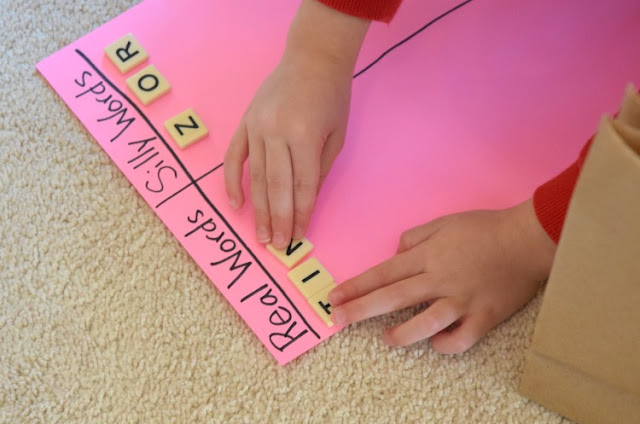 Grab and Sort: CVC Word Building. Fun phonics game for preschoolers or kindergarteners using letter tiles to build and sort simple C-V-C words. Great for early readers.