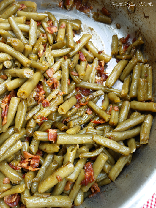 Southern-Style Canned Green Beans! The trick to making perfectly cooked Southern-style green beans with canned beans - the beans don't fall apart but taste like they've cooked all day!
