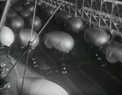 Barrage balloons inside the hangar