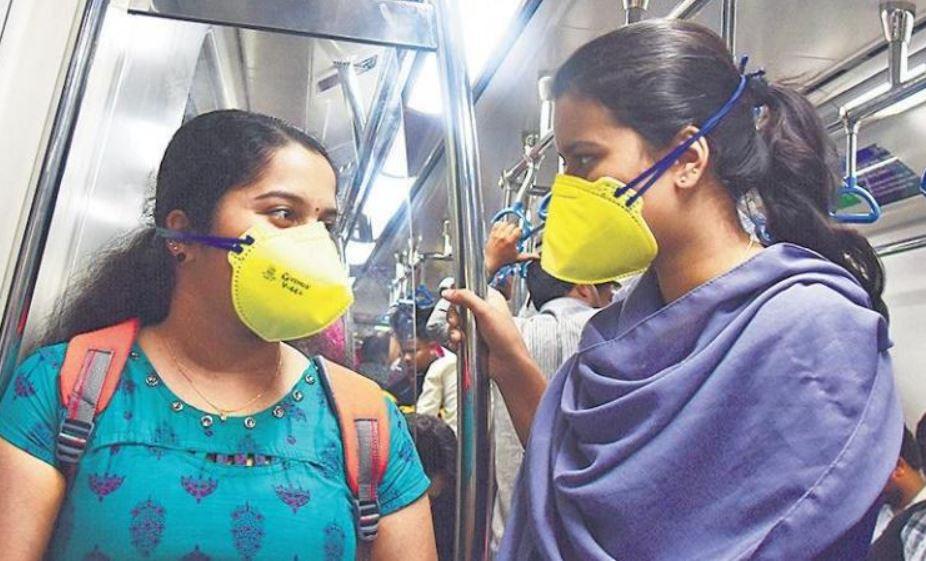 girl in metro train wearing mask