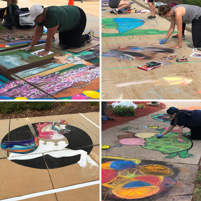 Chalk artists work on creations during the Art Infusion Chalk Art Competition.
