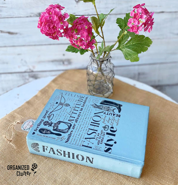 Photo of decorative book upcycle with paint and rub on transfers