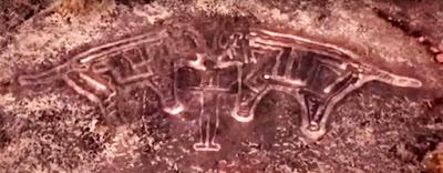 Ratnagiri Petroglyph showing a figure lifting up a pair of tigers.