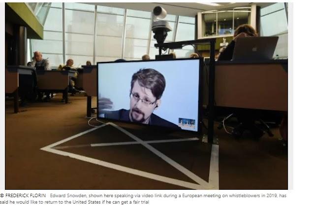 Trump has 'a look' at forgiving Snowden