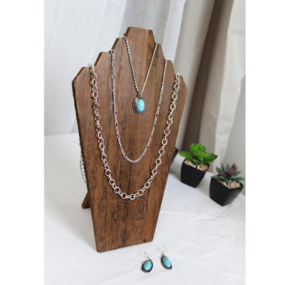 Wooden Jewelry Display Bust Easel in Brown displaying a silver turquoise necklace