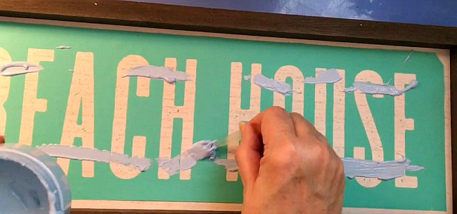 Vintage Paint and more... applying the first color of Chalk Couture chalk paste to a silk screen transfer to make a beach house sign using the ombre method.