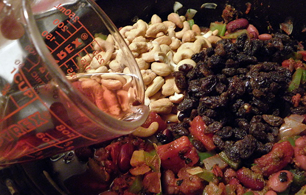 Pouring Wine Vinegar into Colorful Ingredients