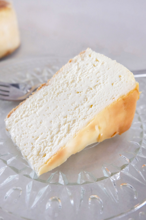 sliced NY style cheesecake on plate