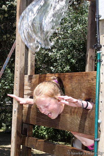 Kasey Wilson, 11, Napier, getting dunked in the Kids Zone at Waimarama Beach Day, a MoreFM fundraiser for Waimarama Surf Lifesaving at Waimarama Beach, Waimarama.  photograph