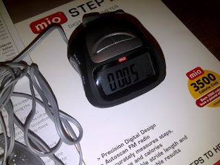Small pedometer and ear buds for radio