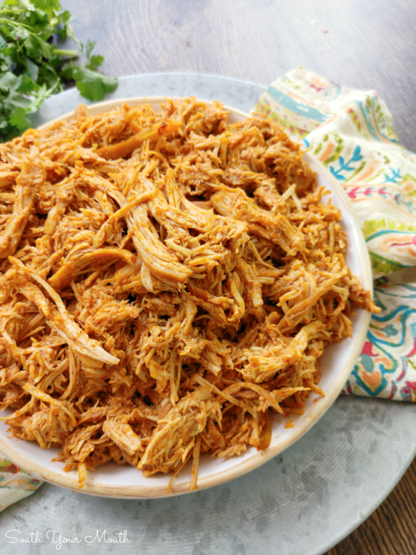 3-Ingredient Crock Pot Chicken Tacos! A super simple slow cooker recipe for shredded Mexican chicken taco meat made with chicken breasts perfect for tacos, burritos, rice bowls and more made with only three ingredients.