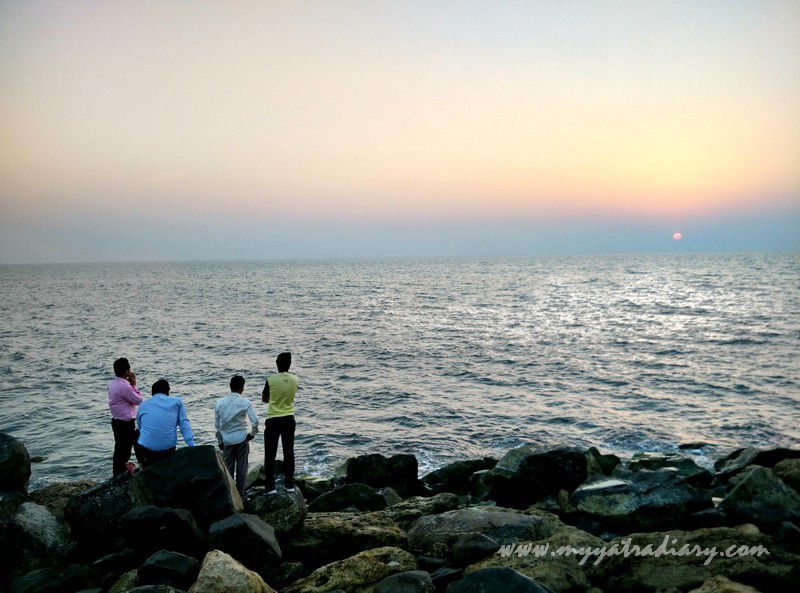 Devouts watching a Sunset at Bhadkeshwar Shiv Temple, Dwarka, Gujarat