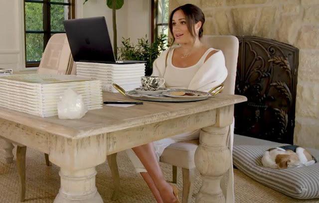 Meghan Markle wears a Zodiac necklace from LA based brand, Logan Hollowell. Twinings UK Tea cup set. Manolo Blahnik pumps