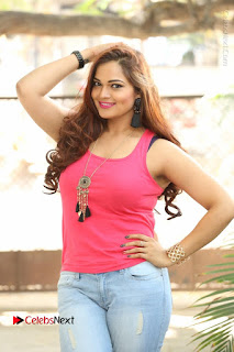 Tollywood Actress Ashwini Latest Stills in Ripped Jeans  0005.JPG