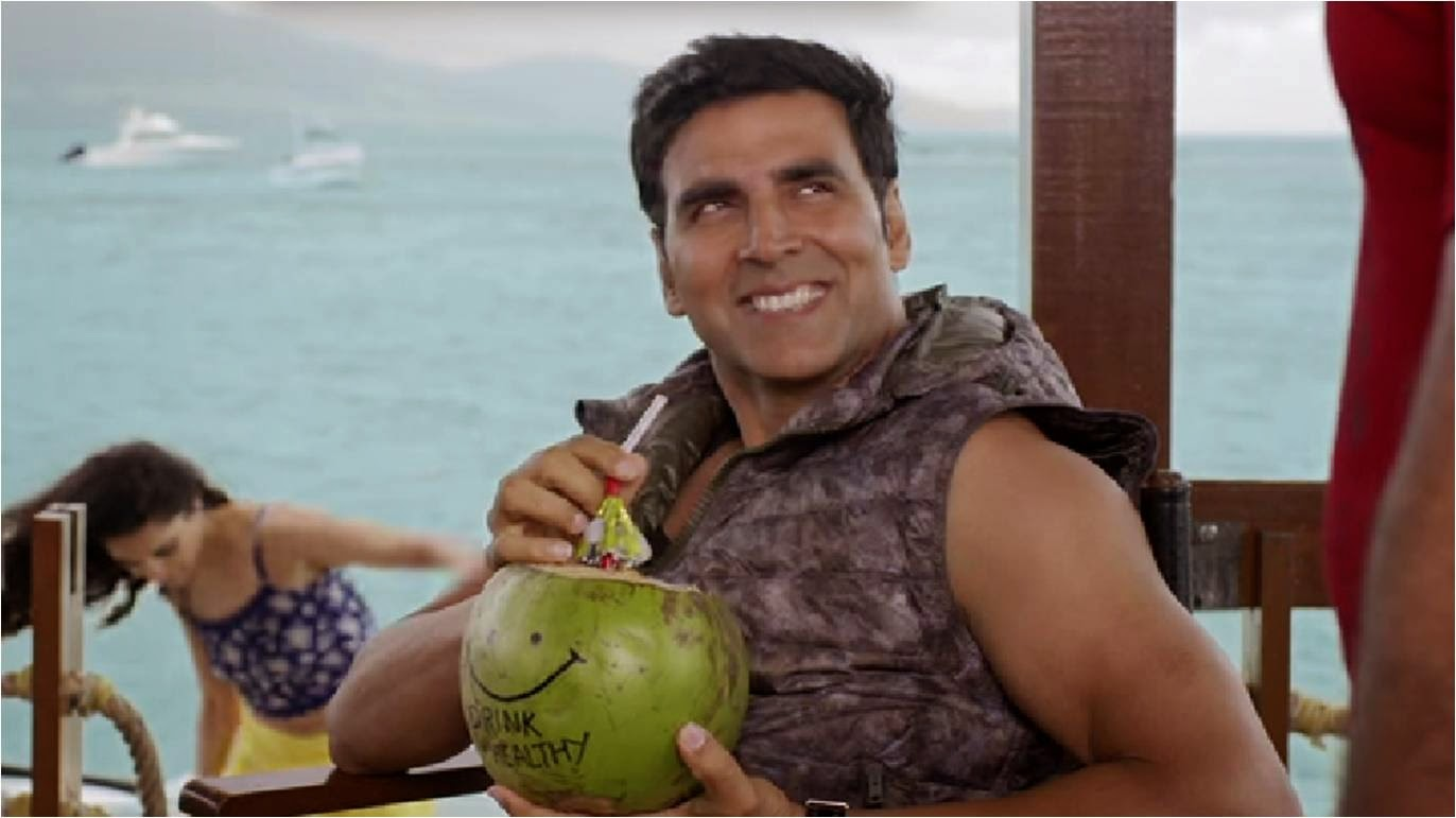 Akshay Kumar sipping coconut water on sea beach in a still of Bollywood movie The Shaukeens