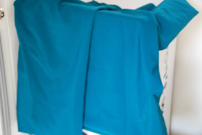 a piece of turquoise fabric
