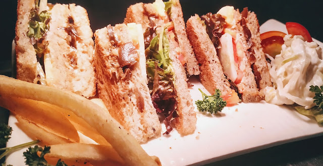 Veg Club Sandwich with Coleslaw and fries food recipe