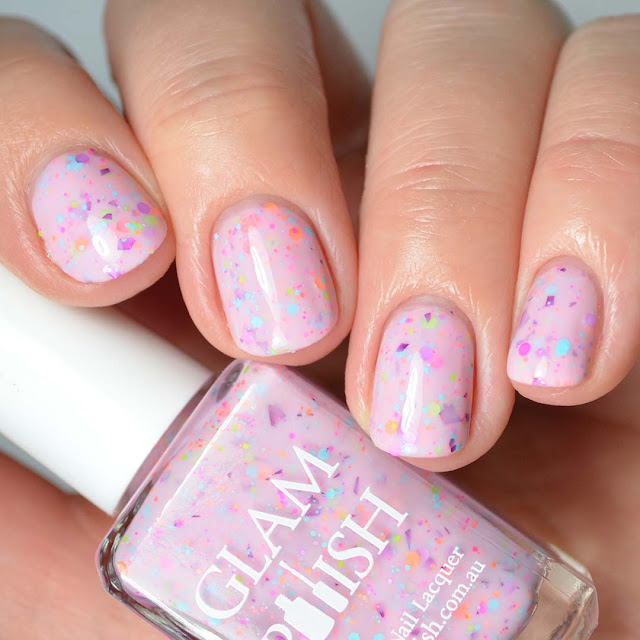 pink nail polish with glitter swatch