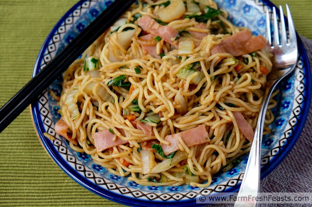 Recipe for vegetables and meat tossed with noodles and sauce for a kid friendly Japanese dish.
