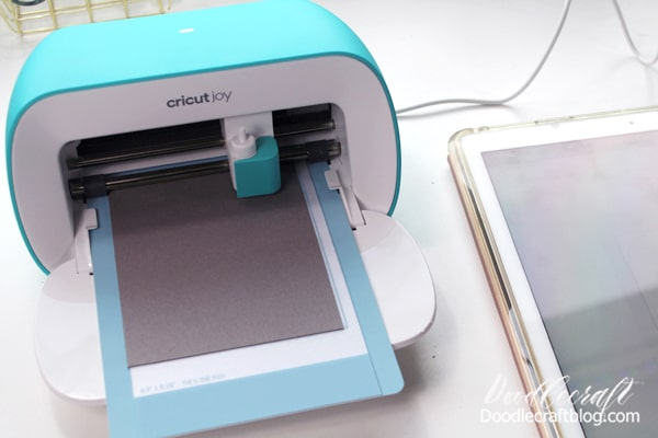 Slip the folded card into the card mat and click go. The little Joy cuts it out with a melodious mechanical hum.
