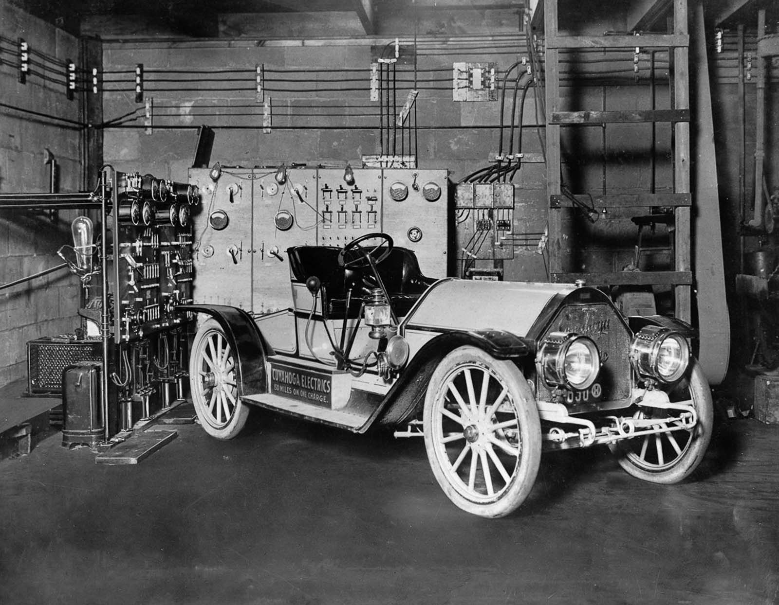 A Mercury Arc Rectifier Charging Set powers up an electric car in a garage in Cleveland, Ohio. 1910.