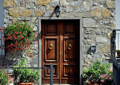 Wooden Door in Castagnoli, Italy - Photo by Taste As You Go