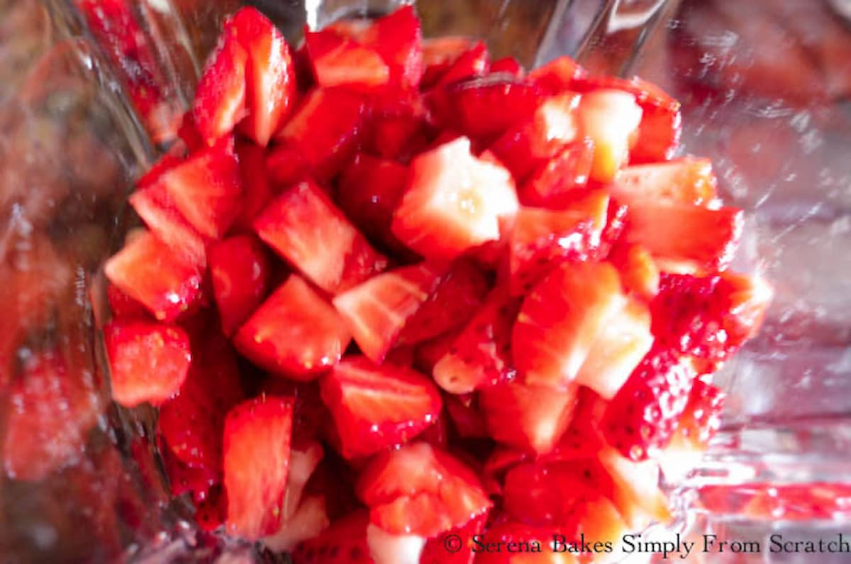 Diced strawberries in a blender.