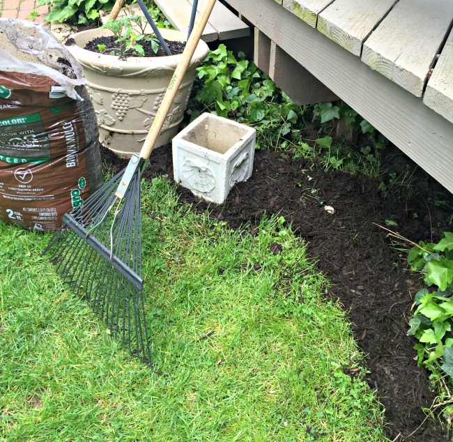 Rake and mulch ready to edge the garden