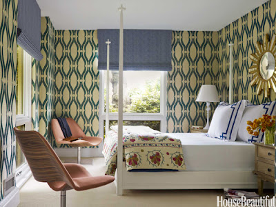 This four poster bed and groovy wallpaper is reminiscent of 60s design.