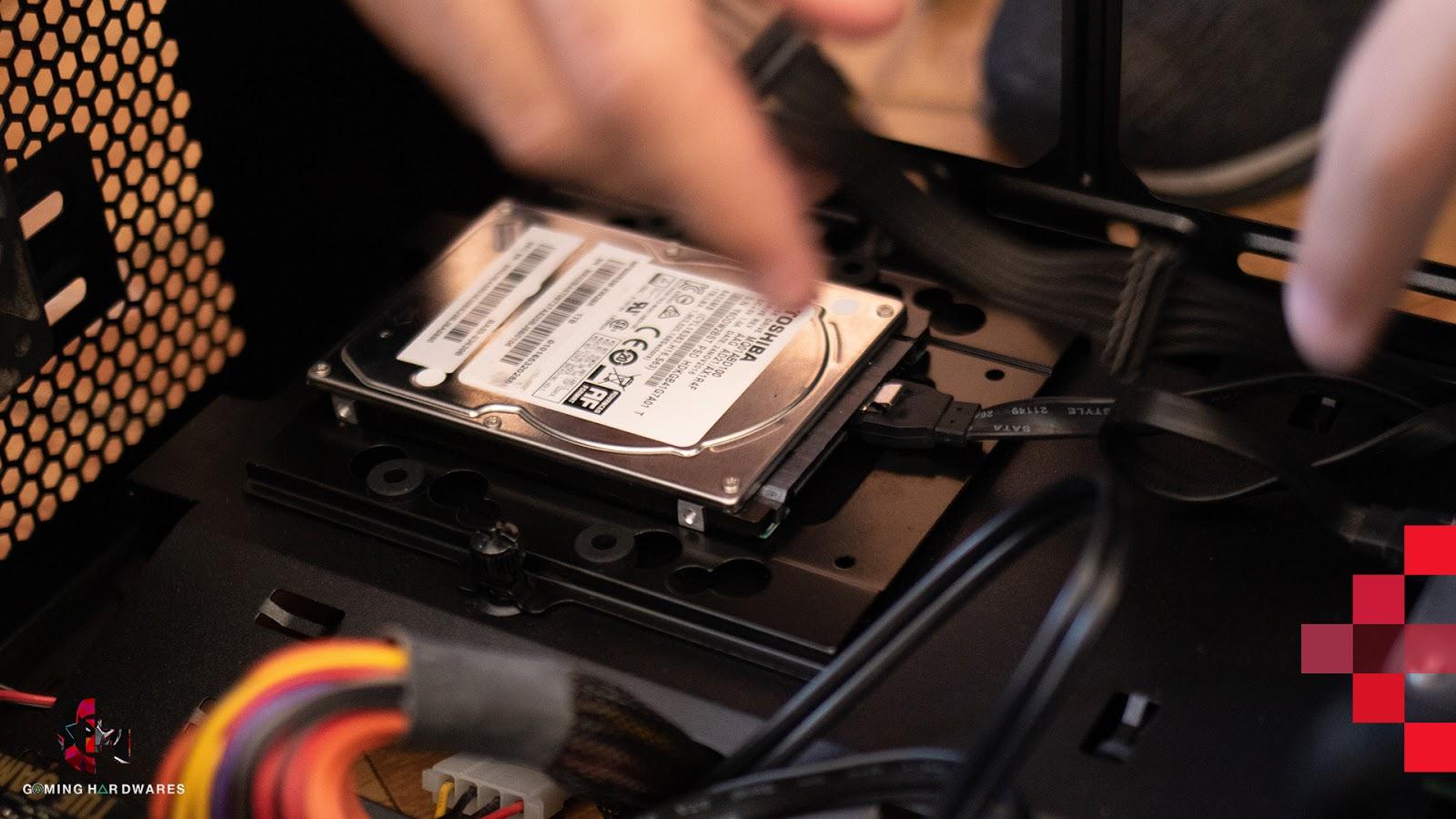 man repairing hard disk