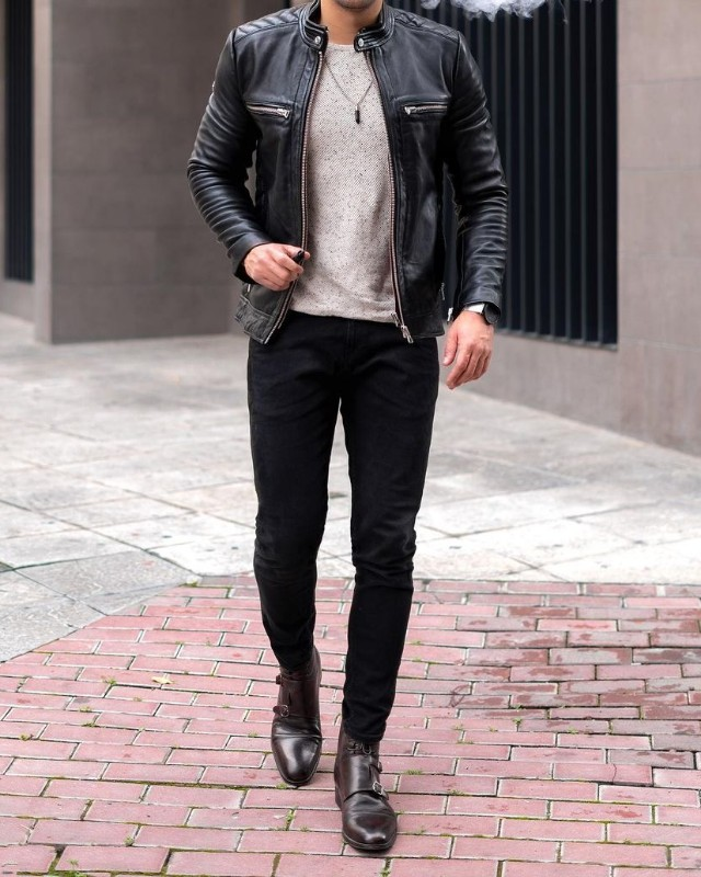 A man wearing Leather jacket, crew neck sweatshirt, slim fit jeans and chelsea boots winter outfit.