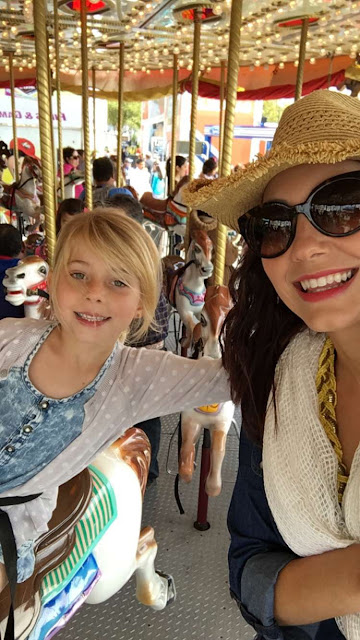 Mother and daughter enjoy a ride at the Houston Rodeo Carnival