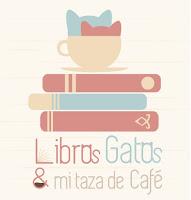 Libros gatos y mi taza de cafe.