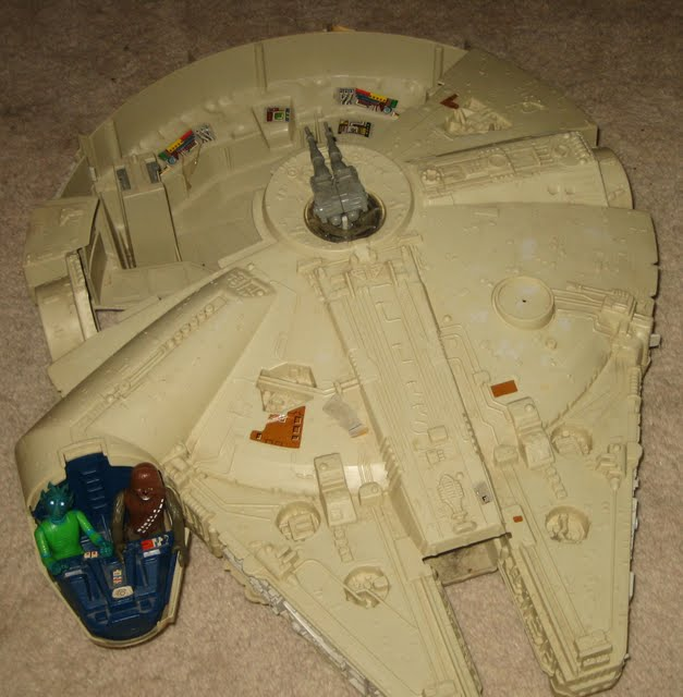 Greedo and Chewbacca figures in cockpit of Millennium Falcon