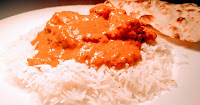 Serving chicken Tikka masala with basmati rice and Naan