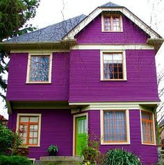An image of purple two story house