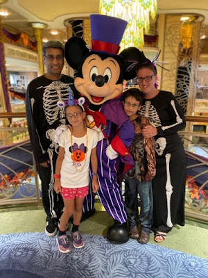 Family with Mickey Mouse in Halloween costumes