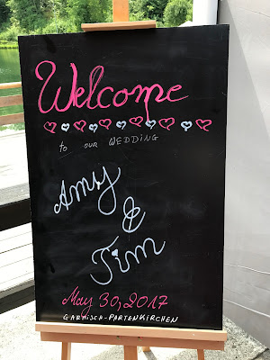 welcome chalk board,  shades of raspberry and apricot, lake-side wedding in the Bavarian mountains, Garmisch-Partenkirchen, Germany, wedding venue Riessersee Hotel, wedding planner Uschi Glas, getting married abroad