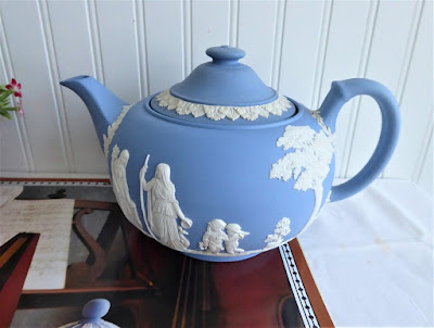 https://timewasantiques.net/collections/wedgwood/products/wedgwood-jasperware-teapot-1953-large-ceres-offering-to-peace-6-cups-blue-and-white