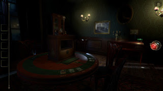 Dark green gothic style room with dark wood furniture and a puzzle box on the table with tarot cards in front