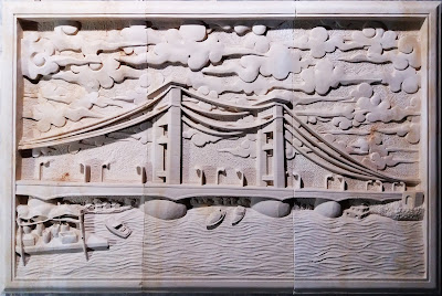 Relief batu alam paras putih motif jembatan ampera