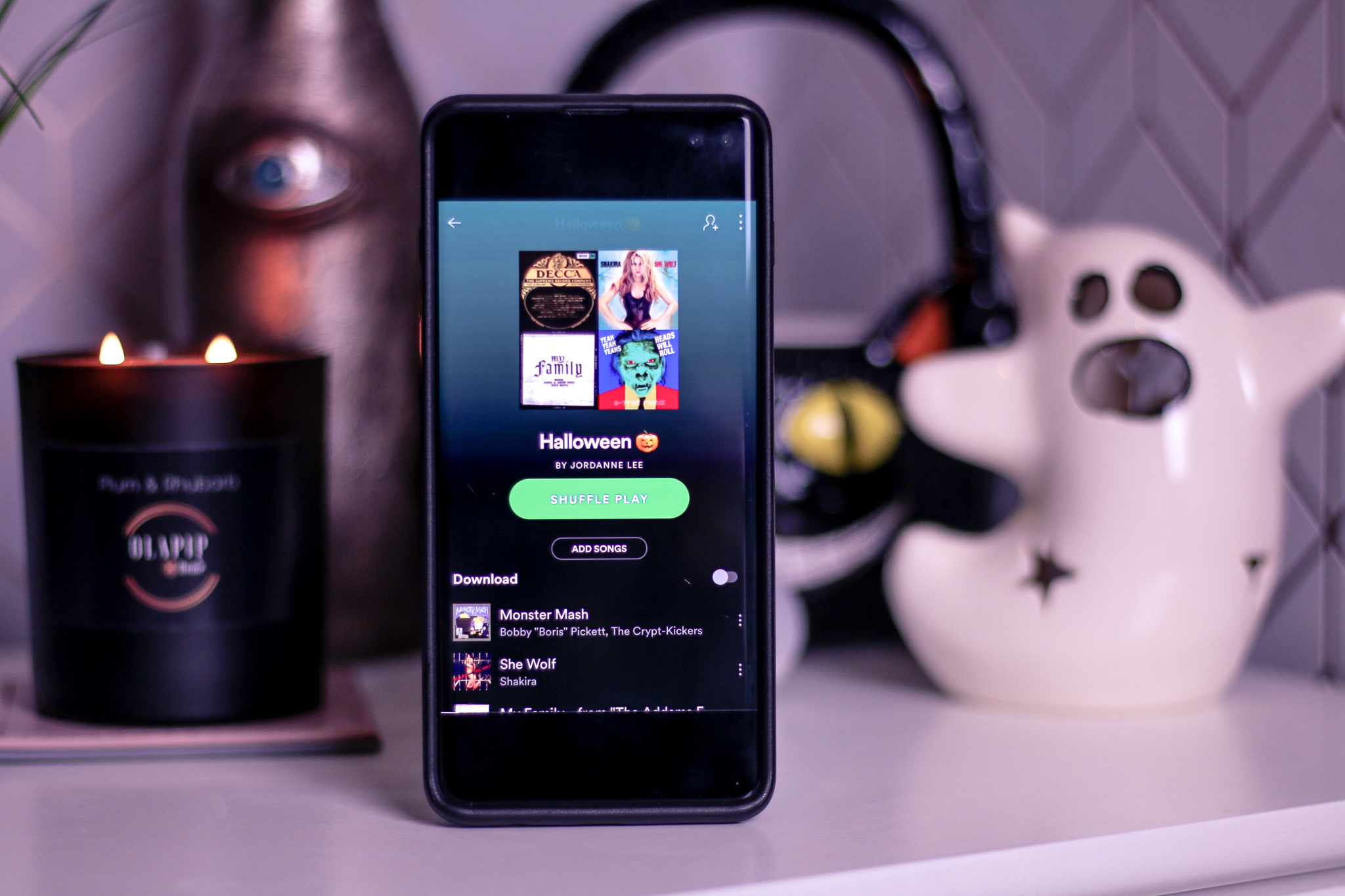 Close up of a Samsung s10+ with a Halloween Spotify playlist showing