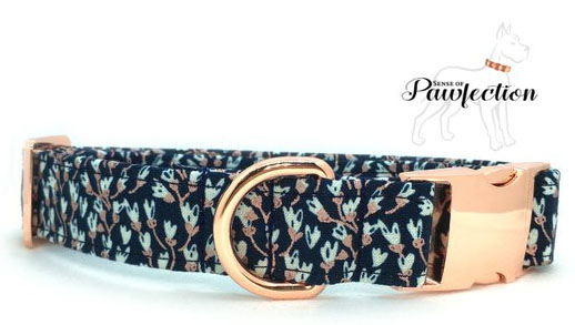 a navy blue collar with pale plue flower pattern and rose gold buckle