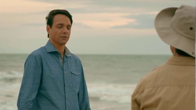 Daniel meets a fisherman on the beach.