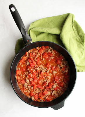 saute pan filled with tomato and ground beef mixture for casserole
