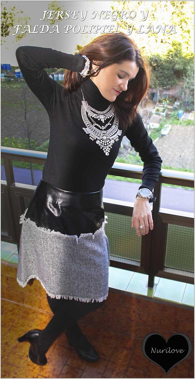 Falda de polipiel y lana negra jaspeada combinada con un jersey negro