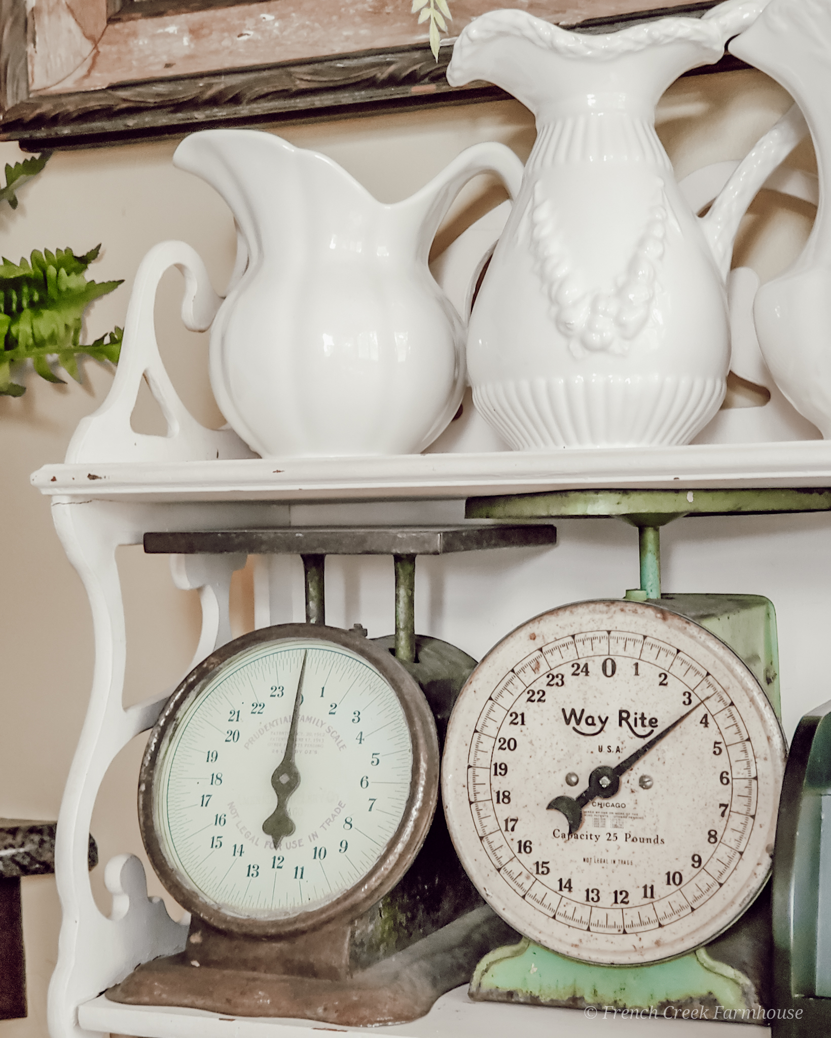 Vintage kitchen scales and ironstone vases on a chippy shelf