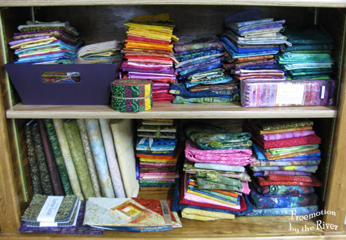 Batik fabric stash on shelves